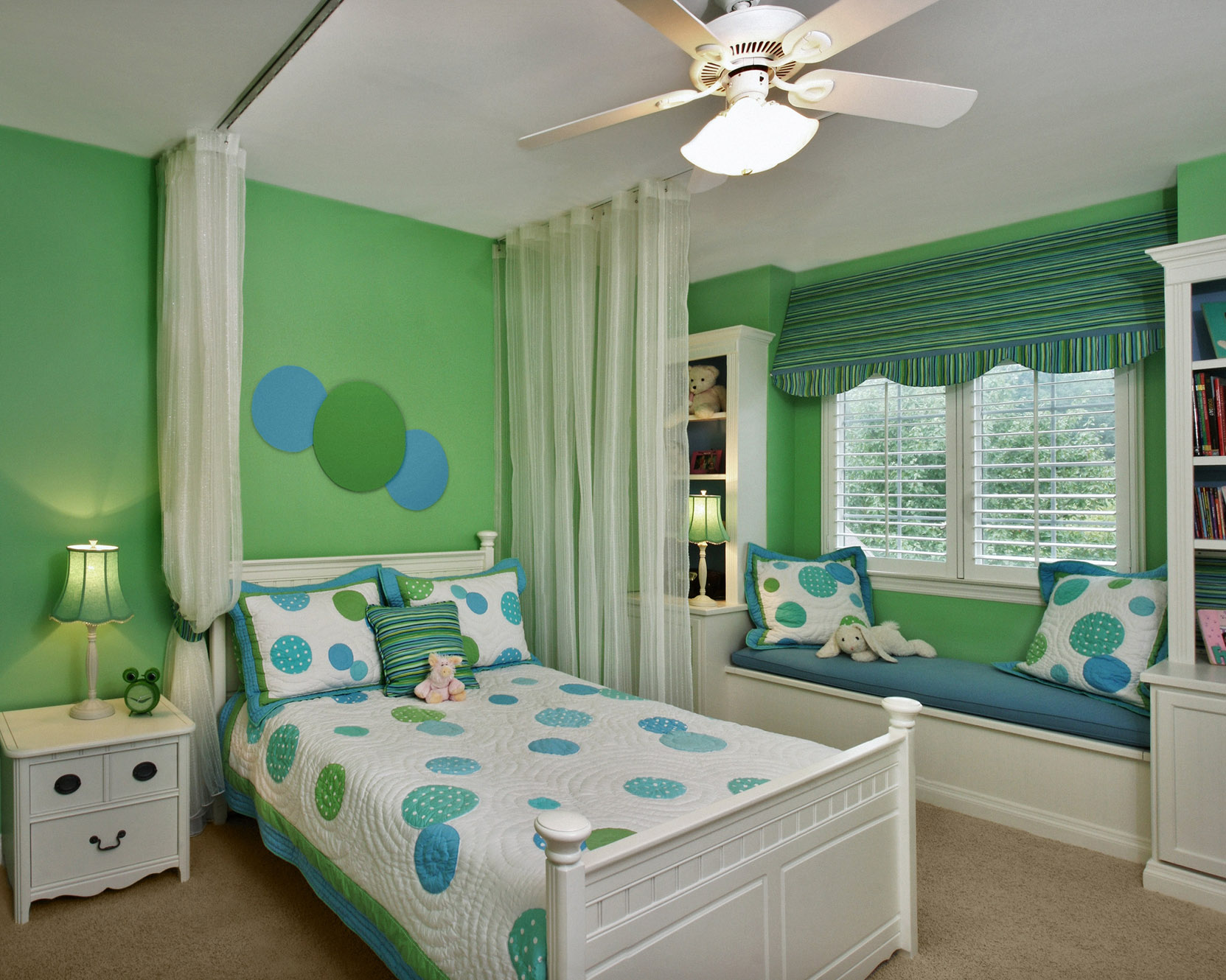 apple green walls set the stage for this fun circle multi colored fabric used in the bedding and accent pillows notice the coordinating striped canopy - Multi Canopy Decor