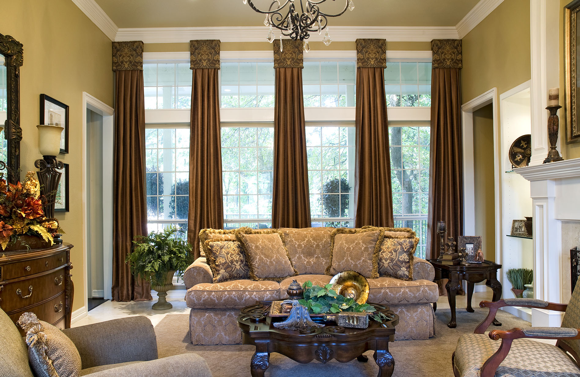 Window treatments with drama and panache decorating den for Den living room designs